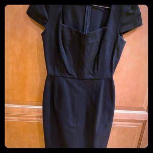 Never worn lovely black sheath dress